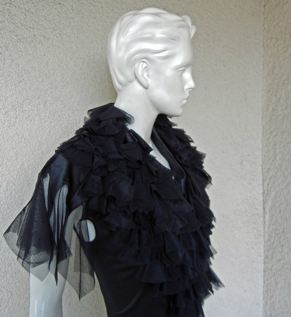 """Pre-death Alexander McQueen rare A/W 2001 """"What a Merry Go Round"""" Collection.     Fashioned of black stretch satin with spiral zipper througout dress allowing to cleverly adjust and regulate openings and closures.  Also boasts raw ruffle"""