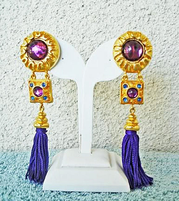 "Stunning vibrant cabachon stone 5"" shoulder duster earrings by Escada.  Rich vibrant purple cabachons with 4 smaller  tanzanite color stones.  Clip-on backs.  Long silk tassels.  Identical to those in runway photo worn by supermodel of the 80's"