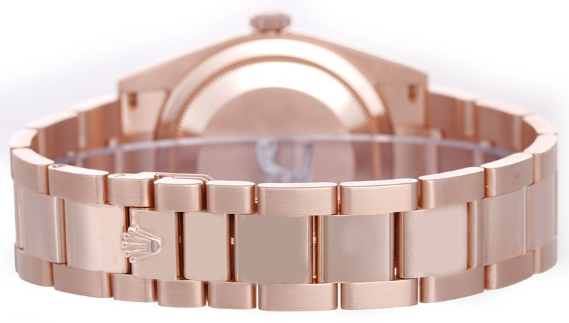 Rolex 18k rose gold and diamond Day-Date President wristwatch, Ref. 118205, with automatic movement, 31 jewels, Quickset, sapphire crystal. 18k rose gold case with smooth bezel (36mm diameter). Rose dial with factory diamond hour markers. 18k rose