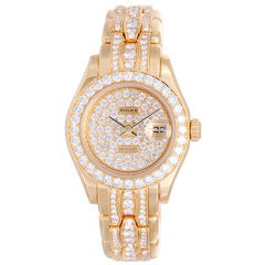 Rolex Lady's Yellow Gold and Diamond Masterpiece/Pearlmaster Wristwatch