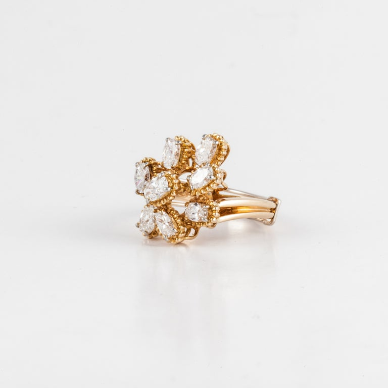 Oscar Heyman Bros. cluster diamond ring in 18K yellow gold with eight oval-cut diamonds that total 1.57 carats; G-H color and VVS-VS clarity.  The ring is a size 6 3/4, can be re-sized.