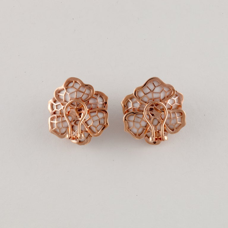 These flower earrings are white onyx with rose gold and diamond trim on the delicate petals. The diamonds weigh 1.85cttw.