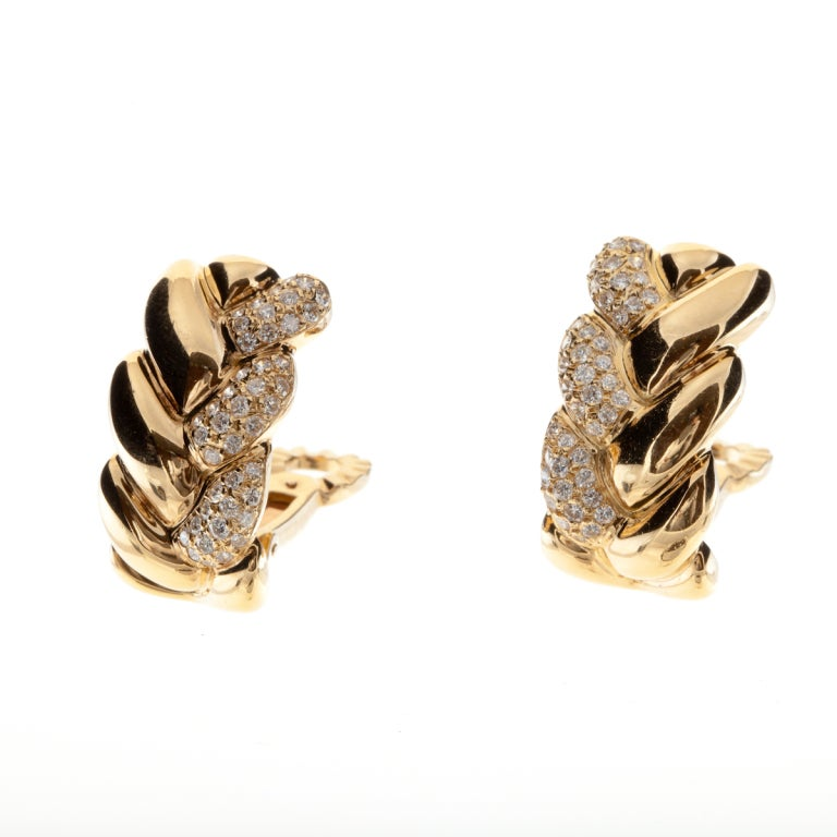 Cartier 18KT yellow gold and diamond earrings in a braided design.  Signed: CARTIER 750