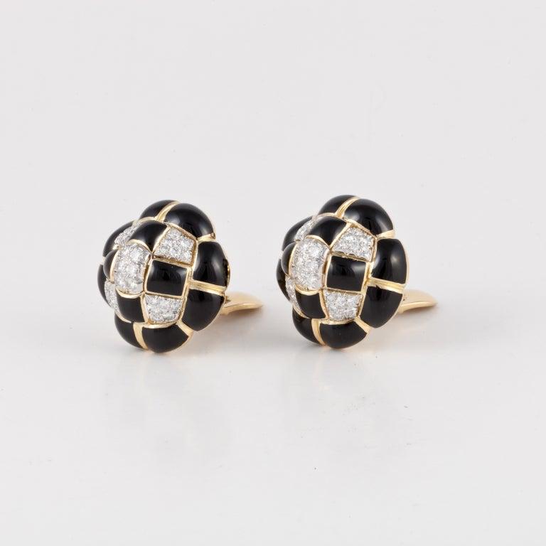 DAVID WEBB Black Enamel, Diamond, Platinum, and 18KT yellow Gold Earrings. Total diamonds are approximately 2.05 carats. Signed - WEBB 18KT PLAT