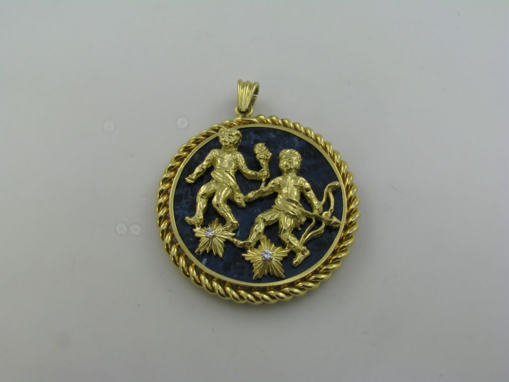 cleef and arpels lapis lazuli gold gemini