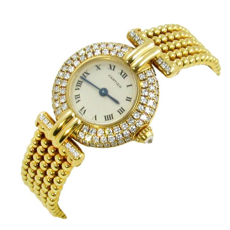 cartier s yellow gold and rivoli wristwatch
