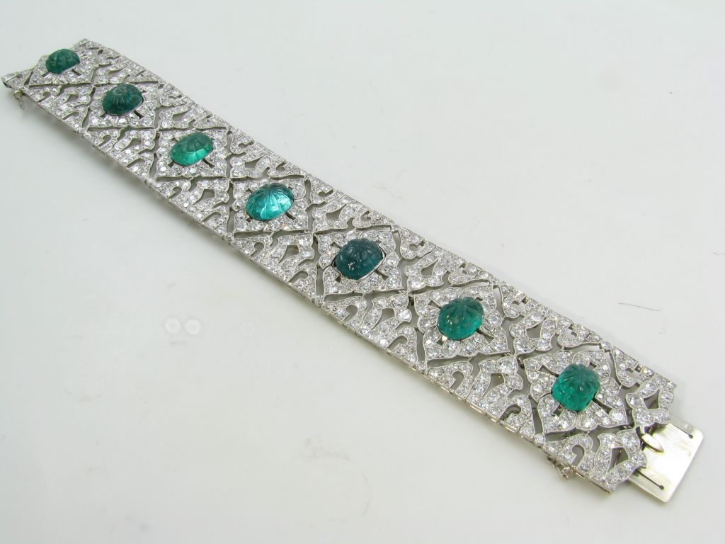 an exquisite carved emerald diamond and platinum bracelet