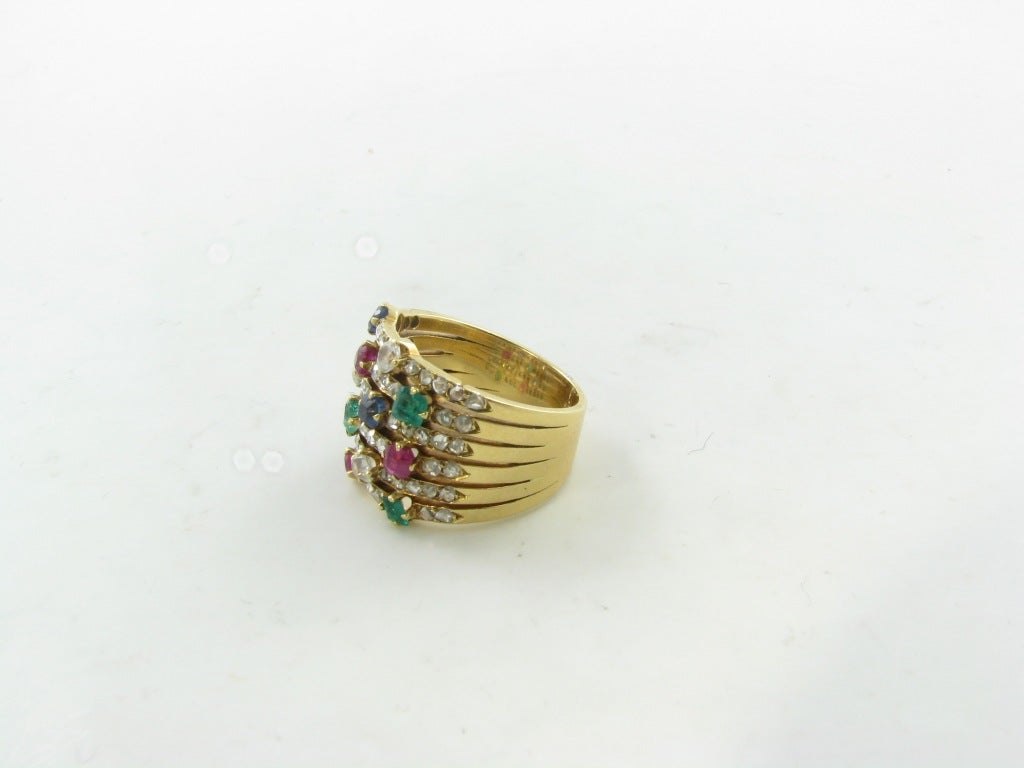 a yellow gold sapphire emerald and ruby