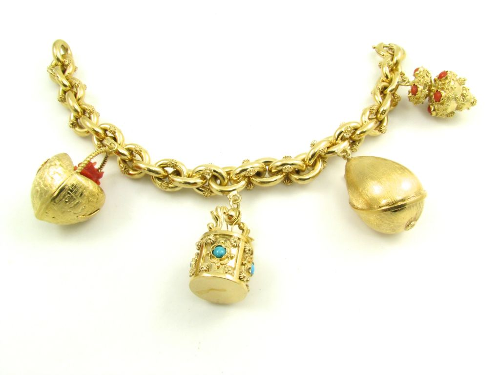 A beautiful yellow gold charm bracelet at 1stdibs