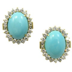 A gorgeous pair of turquoise and diamond earrings.