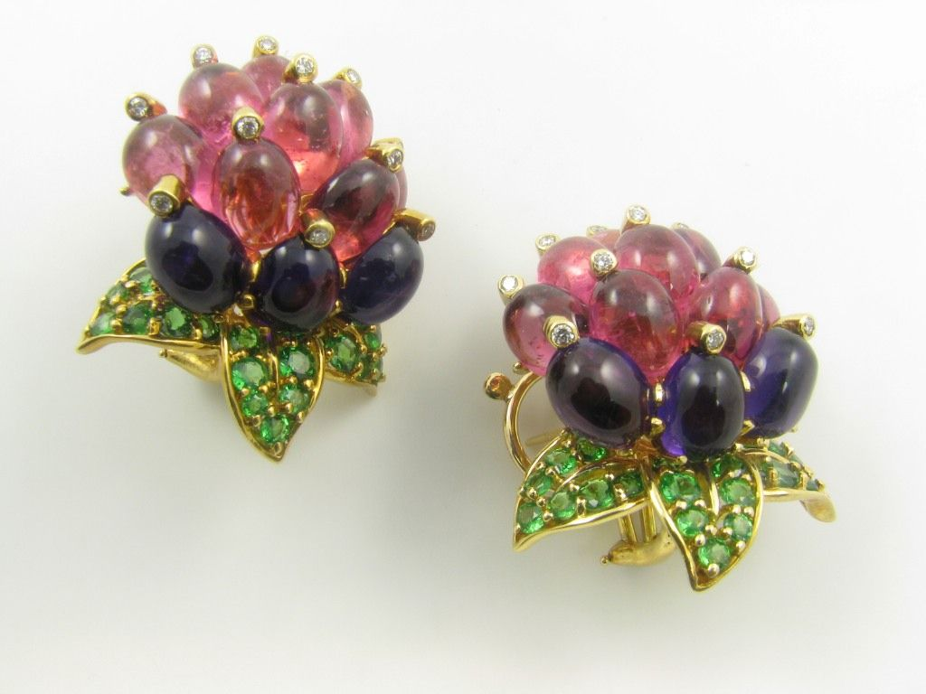 a pair of whimsical multi colored gemstone and