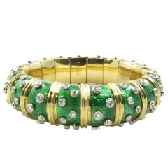 TIFFANY SCHLUMBERGER classic gold, enamel and diamond bangle.