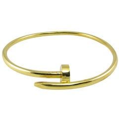 CIPULLO unusual and chic gold curved nail choker style necklace.