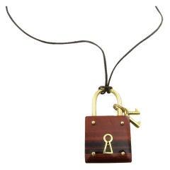 VAN CLEEF & ARPELS chic tigers eye and gold padlock pendant
