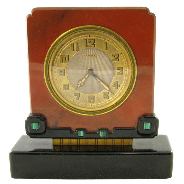 CARTIER Art Deco jasper, black onyx and malachite clock. For Sale