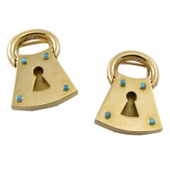 A chic pair of gold and turquoise padlock clips