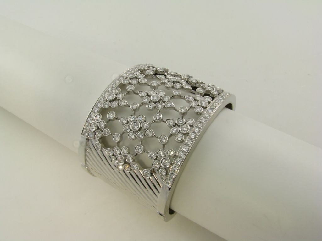 A wide bezel set diamond and white gold cuff bracelet 2