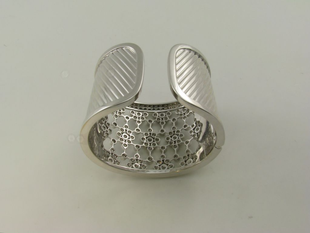 A wide bezel set diamond and white gold cuff bracelet 3