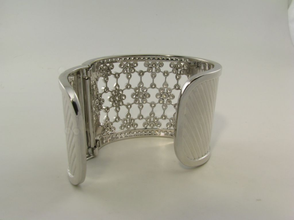 A wide bezel set diamond and white gold cuff bracelet 4