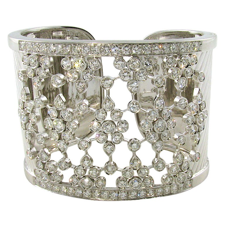 A wide bezel set diamond and white gold cuff bracelet 1