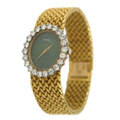 PIAGET Lady's Gold and Diamond Bracelet Watch with Jade Dial