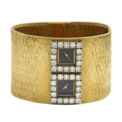 Lady's Yellow Gold and Diamond Dual-Time-Zone Wristwatch
