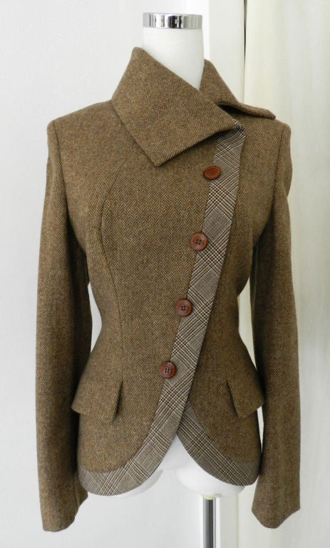 Alexander McQueen brown wool riding jacket.  Closes up the side with 5 buttons, has two front pockets, and pleated design at back hem. Excellent previously owned condition with no flaws. 100% wool.<br />