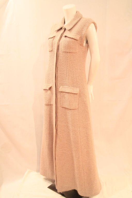 This CHANEL 02A Beige Sleeveless Heavy Wool Tweed Coat Dress evokes the timeless and classic design of Chanel.  As part of the 2002 Chanel Fall/Winter Collection, this item is a must-have.  <br />