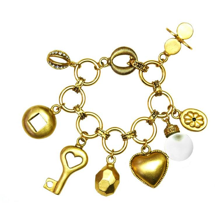 Oscar De La Renta Gold Charm Bracelet At 1stdibs