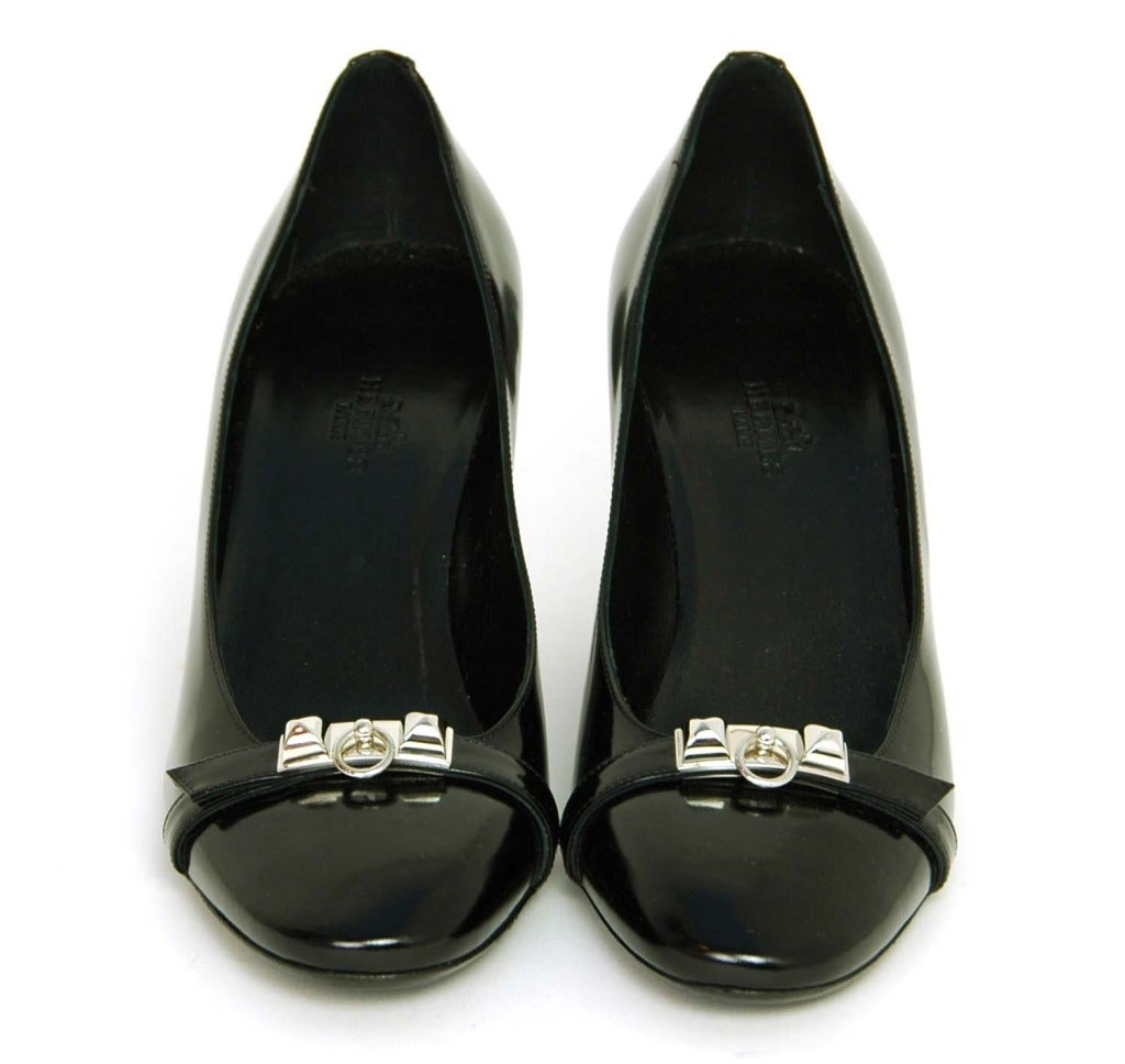 Hermes Black leather Medor Pumps - sz.38 c.2011 Made in Italy Features round toe pump in black leather with silver medor dog collar style hardware including a door knocked and two pyramid studs.  Comes with original box, original receipt,
