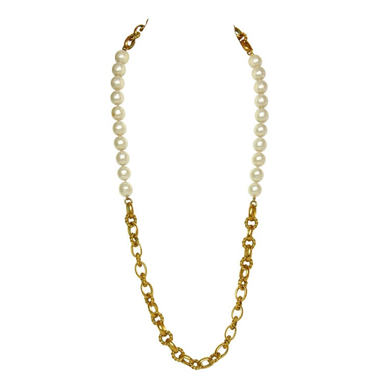 Chanel Vintage '80s Gold Cable Chain Link & Pearl Necklace Made in: France Year of Production: 1980s Color: Ivory and goldtone Materials: Metal and faux pearls Closure: None Stamp: CHANEL MADE IN FRANCE Overall Condition: Good pre-owned condition
