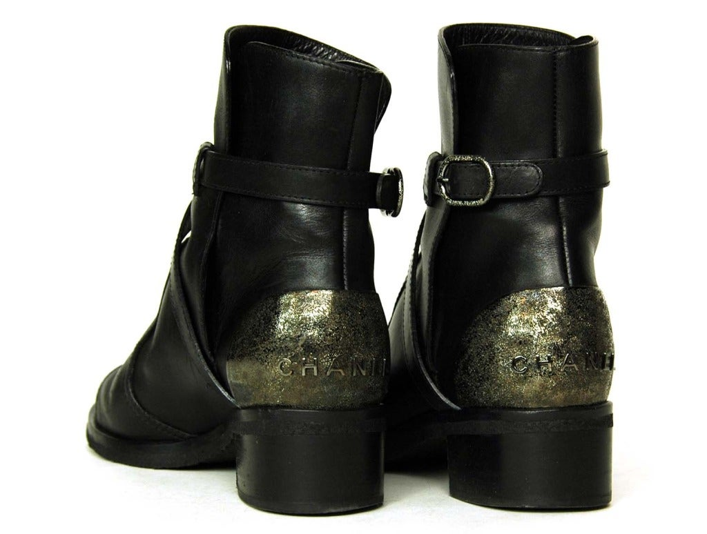 chanel black leather boots w criss cross and metal