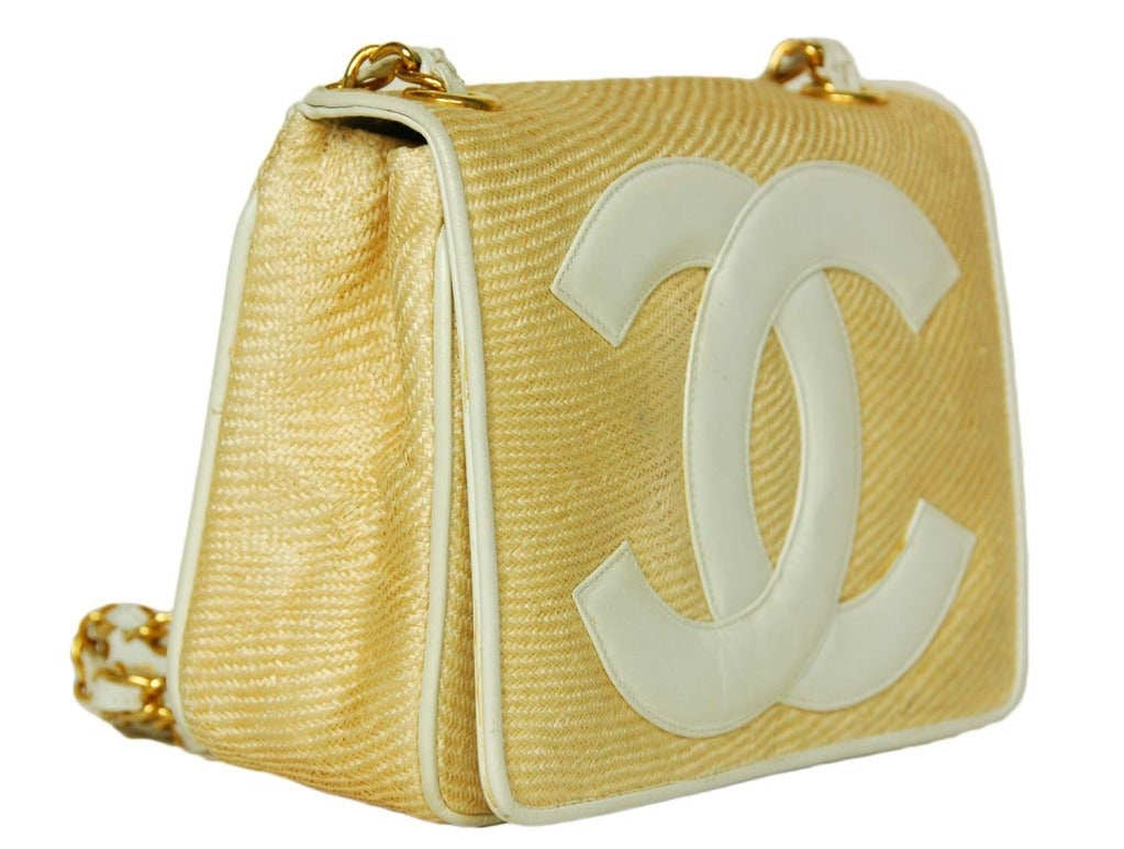 Chanel vintage raffia & leather mini shoulder bag. c.1986 Made in Italy. Beige raffia with ivory leather detail. Large leather CC on front flap. Concealed magnetic snap closure. Signature leather laced chain strap with 18