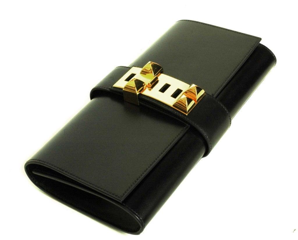 HERMES Black Box Leather Medor Clutch at 1stdibs