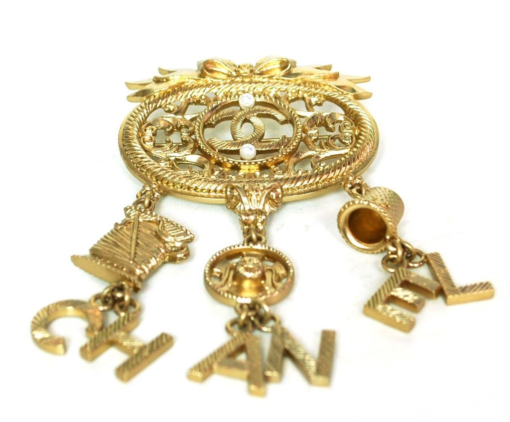CHANEL Goldtone Brooch With Dangling Charms 2