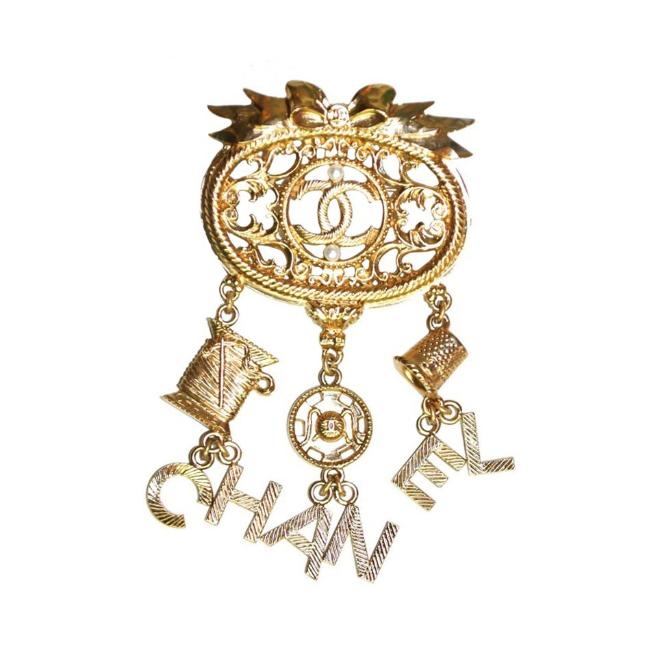 CHANEL Goldtone Brooch With Dangling Charms 1
