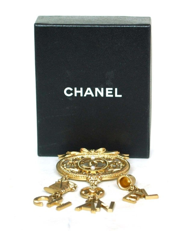 CHANEL Goldtone Brooch With Dangling Charms 4