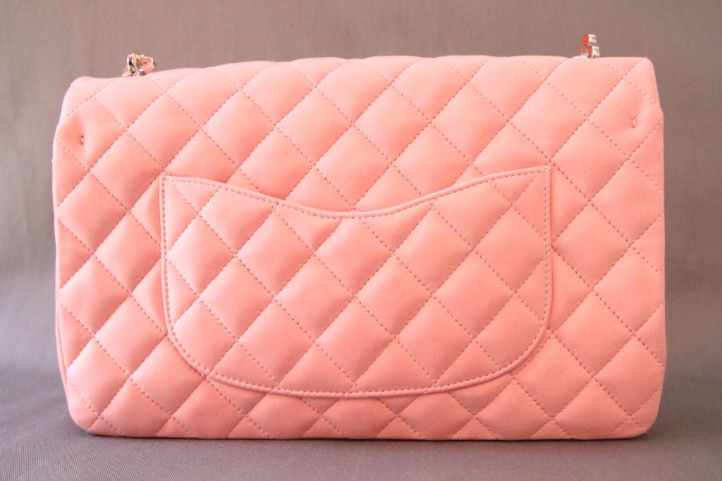 "This stunning CHANEL Valentine Pink Lambskin Quilted 10"" Classic Flap Bag with Heart Chain is a limited edition, and it is a must-have for every Chanel collector!<br />
