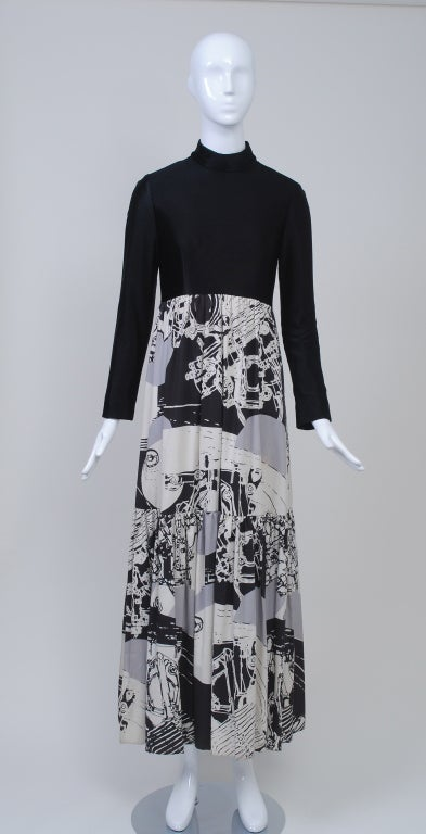 A great 1970s piece from Oscar de la Renta with a contemporary flair. The ankle-length dress features a striking abstract print skirt in gray, black, and white cotton twill that is shirred under the bodice and has a single, deep flounce. An empire