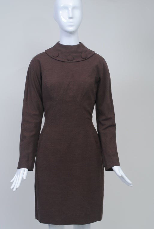 During the 1960s, Oleg Cassini was at the top of his career and best known for designing first lady Jackie Kennedy's wardrobe. From that era comes this light brown wool knit dress with wonderful body shaping accomplished by an inverted V seam in