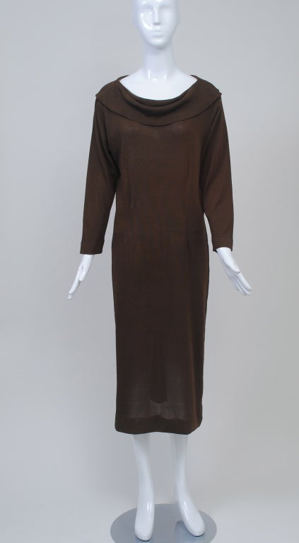 Brioni silky knit dress is lightweight, packable and easy to wear. The dress features a double cowl collar neck in front and single in back and is a basic shift, with shaping darts front and back. Pulls over the head.It would great belted as well.