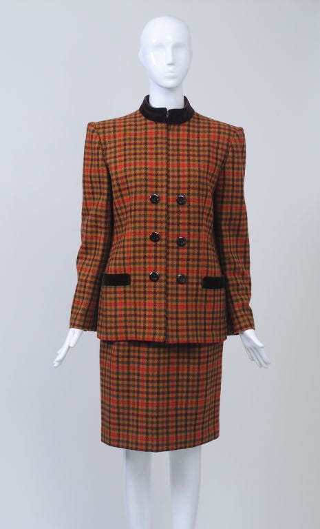 Valentino gold/orange plaid 1980s suit with brown velvet mandarin collar and pocket trim, slim above-the knee skirt, square padded shoulders. Double-breasted effect.