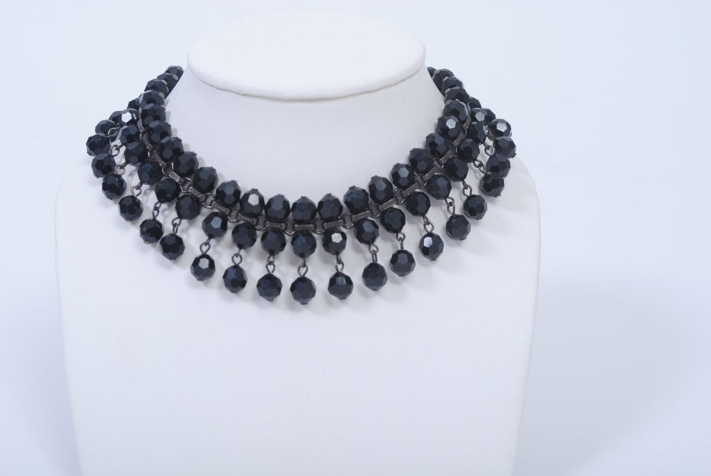 Great look to go with your Gatsby inspired attire, this black jet necklace has three rows of beads, the top two rows rigid and the bottom one dropped. Adjustable chain closure; small size as is, but more beads can be added to expand the size.