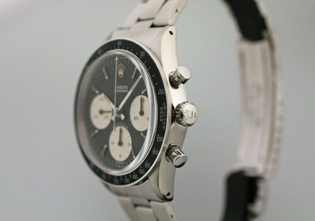 This is a very rare Rolex Daytona reference 6264 in excellent condition. This particular reference rarely appears on the market because it was a transitional model. This watch is in excellent condition with a minty dial and excellent condition case.