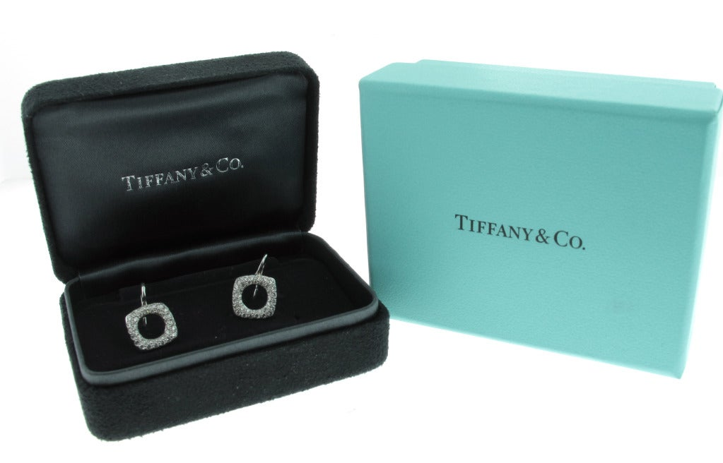 These beautiful Tiffany & Co. diamond drop earrings are set in platinum and feature .90 carats of pave diamonds. The earrings measure 1 cm in width and height and drop about 5 mm off of the ear from a Shepard hook.