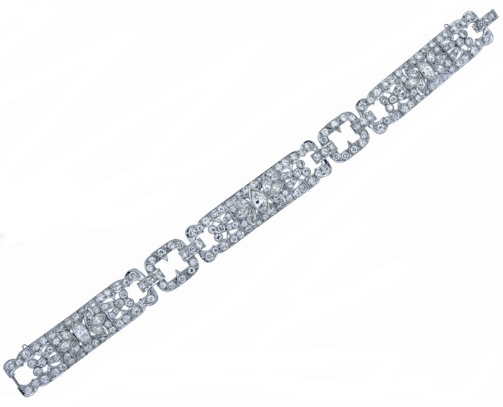 An outstanding Art deco platinum diamond bracelet. The bracelet is adorned with three panels of diamonds featuring a center marquise diamond and highlighted with six additional marquise diamonds. Set in platinum the bracelet contains 173 round
