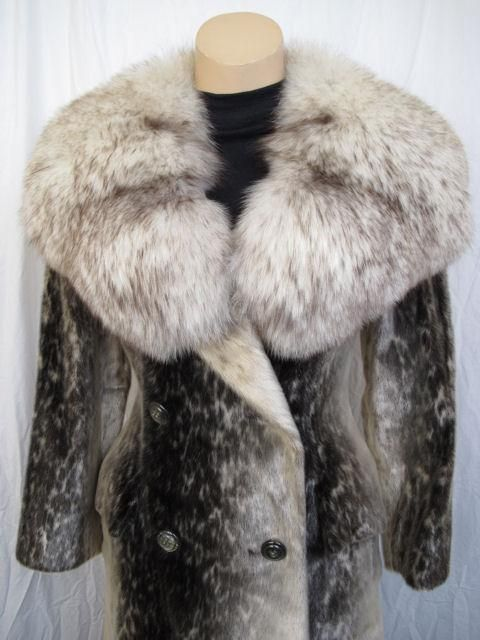 This coat is simply breathtaking! One can only imagine the amount of work it took to create such a phenomenal coat! Birger Christensen is known for extremely light and perfectly fitting coats.<br /> <br /> * It has a beautiful huge fur collar.<br