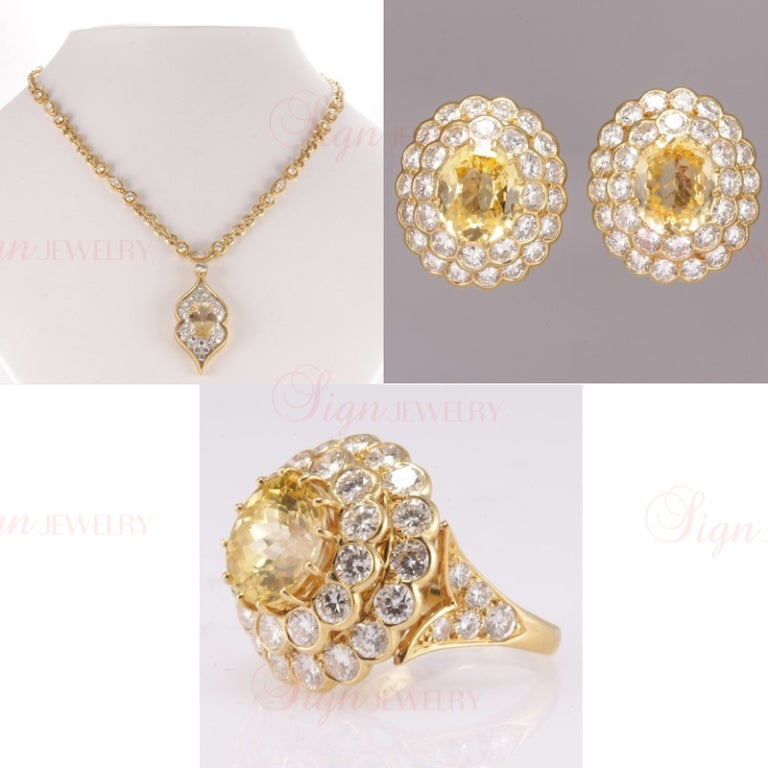 From the Estate of Lucille Ball comes this brilliant Van Cleef & Arpels ring, earrings, and necklace set. In pristine shape. Featuring sunny 18k yellow gold, exquisite diamonds (totaling 21 carats), and sapphires (totaling 16 carats). Lucille Ball
