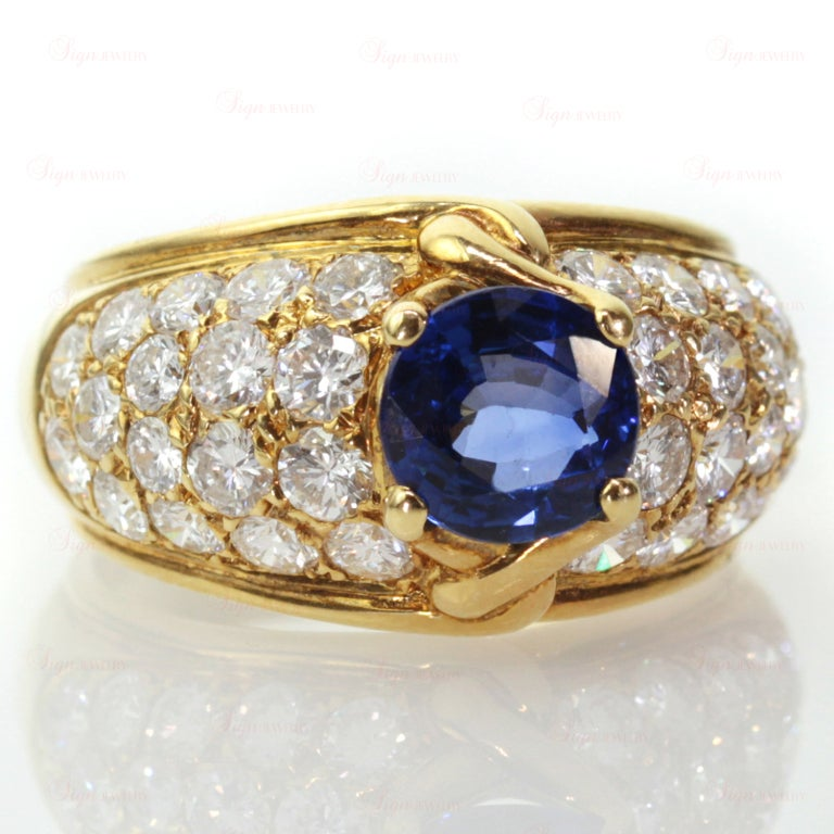 Fabulous women's ring from Van Cleef and Arpels made in 18k yellow gold and featuring a faceted 7.0mm round sapphire center stone in sparkling bright royal blue color. Completed by a stunning pave-setting of surrounded by round diamonds. Circa