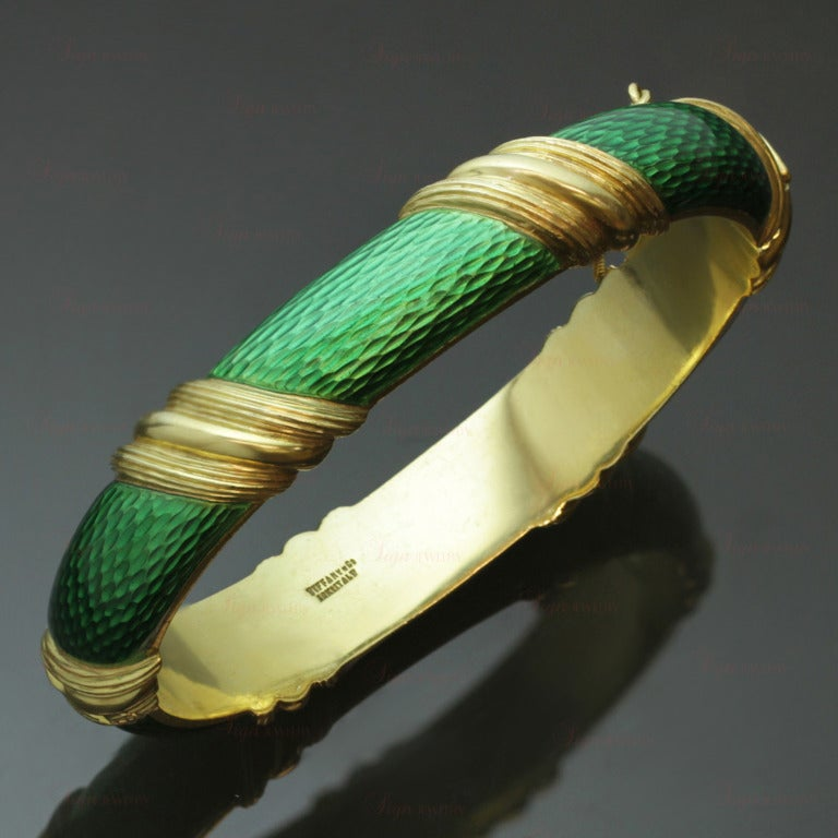 This fabulous Tiffany & Co. bangle bracelet features textured green enamel set in 18k yellow gold and completed with a safety clasp. A vibrant and chic circa 1990s design.